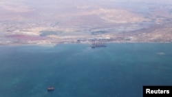 FILE - An aerial view shows the coastline of the Caspian Sea near Baku, Azerbaijan, May 27, 2019.