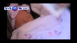 Cha mẹ em bé sinh trên vỉa hè New York tìm ân nhân nhường áo