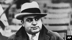 FILE - Chicago mobster Al Capone attends a football game, Jan. 19, 1931.