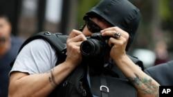 Himoya kiyimidagi fotojurnalist, Mexiko shahri, Meksika, 2019-yil, 21-avgust