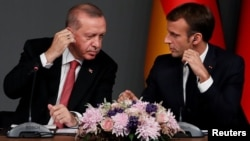 Archive: Turkish President Tayyip Erdogan and French President Emmanuel Macron attend a news conference after a Syria summit, in Istanbul, Turkey October 27, 2018. REUTERS/Murad Sezer
