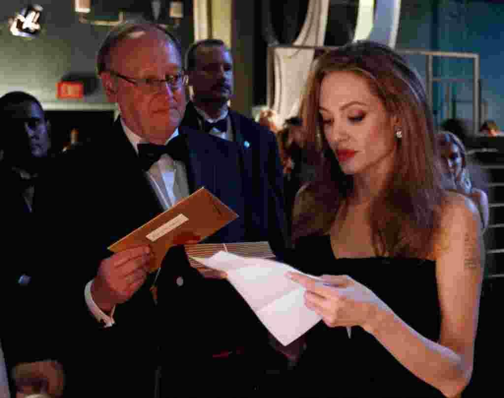 Presenter Angelina Jolie prepares to go onstage. (AP)