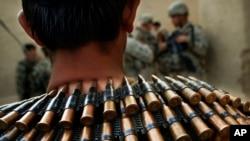 FILE - An Afghan soldier wears an ammunition belt around his neck, near Kandahar.