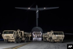 In this photo provided by U.S. Forces Korea, trucks carrying U.S. missile launchers and other equipment needed to set up the Terminal High Altitude Area Defense (THAAD) missile defense system arrive at the Osan air base in Pyeongtaek, South Korea, March 6, 2017.
