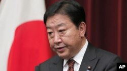 Japanese Prime Minister Yoshihiko Noda speaks during a press conference at his official residence in Tokyo, August 24, 2012.