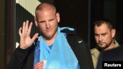 FILE - U.S. serviceman Spencer Stone waves as he departs the Clinique Lille Sud, which specializes in hand injuries, in Lesquin, France, Aug. 22, 2015.
