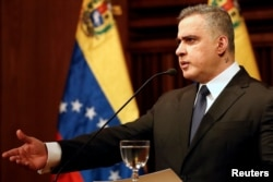 Venezuela's chief prosecutor Tarek William Saab gestures as he talks to the media during a news conference in Caracas, Venezuela, Nov. 2, 2017.