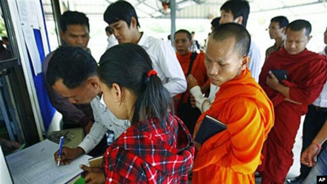 Cambodians and Buddhist monks register at the UN-backed war crimes tribunal for the three-day hearing of the former Khmer Rouge top leaders, Nuon Chea, who was Pol Pot's No. 2 and the group's chief ideologist, and Ieng Thirith, former minister of social a
