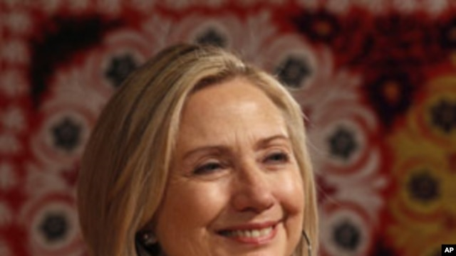 U.S. Secretary of State Hillary Rodham Clinton smiles at a town hall discussion in Dushanbe, Tajikistan, Oct 22, 2011.