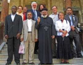 2010 Citizen Diplomat Award honoree Sahar Taman (back row in red) visits an Egyptian Coptic church with one of her tour groups in May 2009.