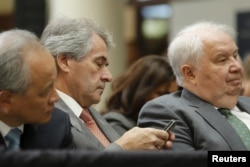 FILE - Russia's Ambassador Sergey Kislyak from right, U.K. Ambassador Peter Westmacott and China's Ambassador Cui Tiankai wait for U.S. President Barack Obama to deliver remarks on a nuclear deal with Iran at American University, Aug. 5, 2015.