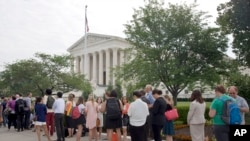 FILE - People stand in line hoping to enter the Supreme Court in Washington, Friday June 26, 2015.