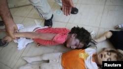 活动人士称,8月21日在大马士革郊区死于毒气袭击的儿童的遗体