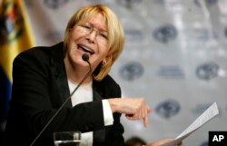 FILE - Venezuela's Chief Prosecutor Luisa Ortega gives a press conference in Caracas, Venezuela, July 4, 2017.