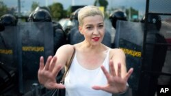 FILE - Maria Kolesnikova, one of Belarus' opposition leaders, gestures during a rally in Minsk, Belarus, Aug. 30, 2020.
