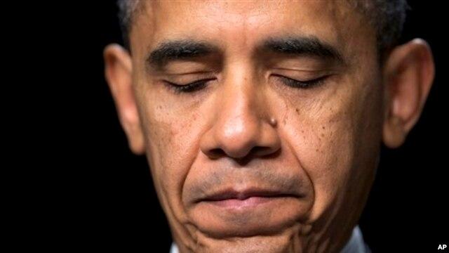 President Barack Obama pauses as he speaks at the National Prayer Breakfast, Washington, Feb. 7, 2013.