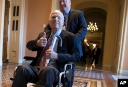 Sen. John McCain, R-Ariz., leaves a closed-door session on Capitol Hill in Washington, Dec. 2017. (File Photo)