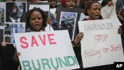 FILE - Burundi nationals from across the U.S. and Canada, along with supporters, demonstrate outside U.N. headquarters in New York, calling for an end to political atrocities and human rights violations unfolding in Burundi under the government of President Pierre Nkurunziza, April 26, 2016.