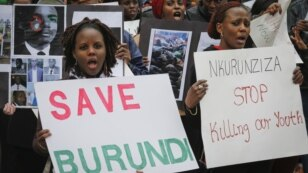 FILE - Burundi nationals from across the U.S. and Canada, along with supporters, demonstrate outside U.N. headquarters, calling for an end to political atrocities and human rights violations unfolding in Burundi under the government of President Pierre Nkurunziza on April 26, 2016, in New York.
