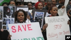 FILE - Burundi nationals from the U.S. and Canada and their supporters demonstrate outside U.N. headquarters in New York, calling for an end to political atrocities and human rights violations under the government of President Pierre Nkurunziza, April 26, 2016.