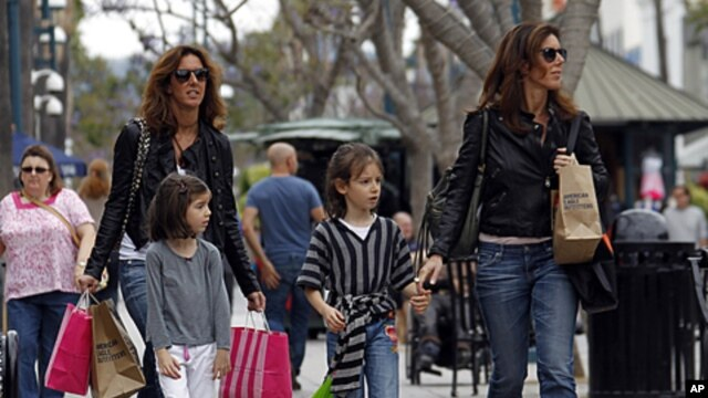 Women and girls carry purchases on the Third Street Promenade in Santa Monica, Calif., April 24, 2012.
