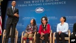 President Barack Obama speaks as, from left, Tatiana Ticknor of the Yup'ik/Tlingit/Dena'ina, Brayden White of the St. Regis Mohawk Tribe and Blossom Johnson of the Navajo Nation listen during the 2015 White House Tribal Nations Conference, Nov. 5, 2015.
