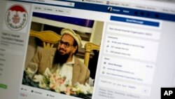 A photo shows a Facebook site that features one of India's most wanted, Hafiz Saeed, the founder of Lashkar-e-Taiba, a banned organization and a U.S. declared terrorist group, in Islamabad, Pakistan, July 7, 2017. A senior Pakistani government official says more than 40 of 65 organizations banned in Pakistan operate flourishing social media sites, communicating on Facebook, Twitter, WhatsApp and Telegram to recruit, raise money and demand a rigid Islamic system. Meanwhile Pakistan is waging a cyber war against activists and journalists who use social media to criticize the government and its agencies.