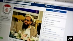 A photo shows a Facebook site that features one of India's most wanted, Hafiz Saeed, the founder of Lashkar-e-Taiba, a banned organization and a U.S. declared terrorist group, in Islamabad, Pakistan, July 7, 2017.