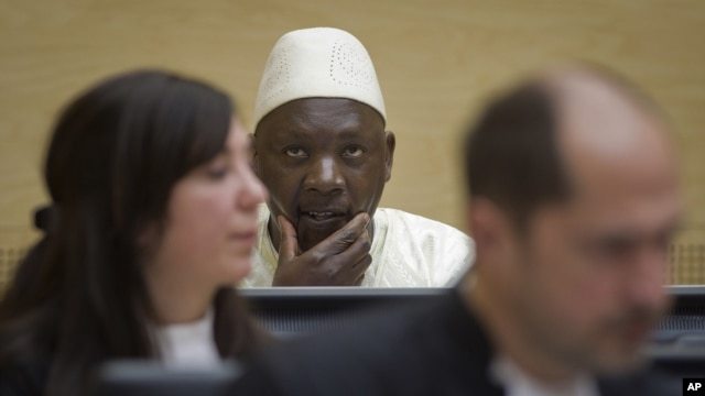 Congolese warlord Thomas Lubanga, center, awaits his verdict in the courtroom of the International Criminal Court in The Hague, Netherlands, March 14, 2012.