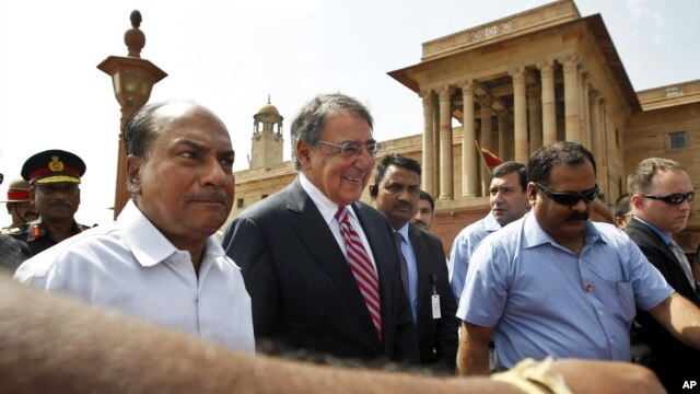 U.S. Defense Secretary Leon Panetta, second left, walks with Indian Defense Minister A.K. Antony, left, to the defense minister's office, in New Delhi, India, Wednesday, June 6, 2012.