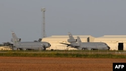 File - US warplanes are seen at the Moron air base, near Seville.