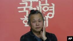 South Korean director Kim Ki-duk poses before an interview at the Busan International Film Festival in Busan, South Korea, October 5, 2015
