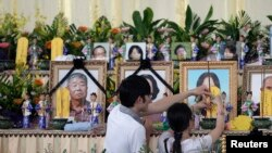 Relatives Mourn Taiwan Plane Crash Victims