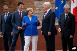G-7 leaders, from left, President of the European Commission Jean-Claude Junker, Canadian Prime Minister Justin Trudeau, German Chancellor Angela Merkel, President Donald Trump, and Italian Prime Minister Paolo Gentiloni, pose for a family photo at the Anc