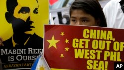 In this file photo, activists march towards the Chinese Consulate to protest Chinese territorial claims in the South China Sea in June 12, 2014.