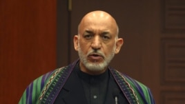 Afghan President Hamid Karzai speaks to the media during a news conference, December 12, 2012.