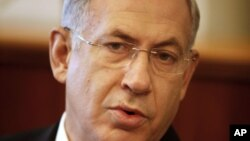Israeli Prime Minister Benjamin Netanyahu speaks at the weekly Cabinet meeting at his office in Jerusalem, July 22, 2012.