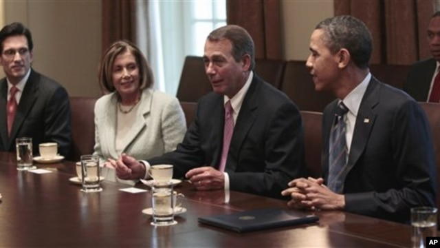 President Barack Obama listens to House Speaker John Boehner of Ohio, second from right, during a bipartisan meeting with House and Senate leadership in the Cabinet Room of the White House in Washington, April 13, 2011