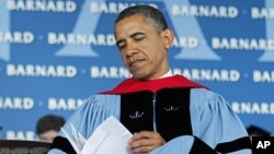 President Barack Obama reads over a program before delivering the commence address at Barnard College, New York, May 14, 2012.
