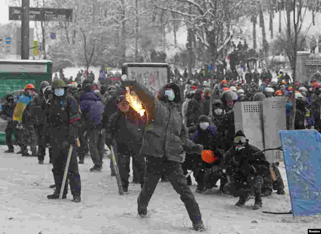 A pro-European protester throws a Molotov cocktail during clashes with police in Kyiv, Jan. 22, 2014.