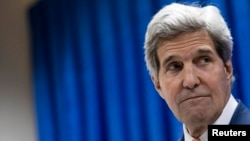 U.S. Secretary of State John Kerry pauses as he speaks during a news conference at the U.S. embassy in the International Zone in Baghdad, June 23, 2014