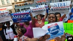 "FILE - Federal employees from the New York metropolitan area chant slogans during a ""Proud to Work for America"" rally in support of the federal workforce, July 19, 2011, in New York."