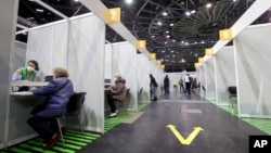 People get their COVID-19 vaccines at a new vaccination center at the Velodrom in Berlin, Germany, Feb. 17, 2021.