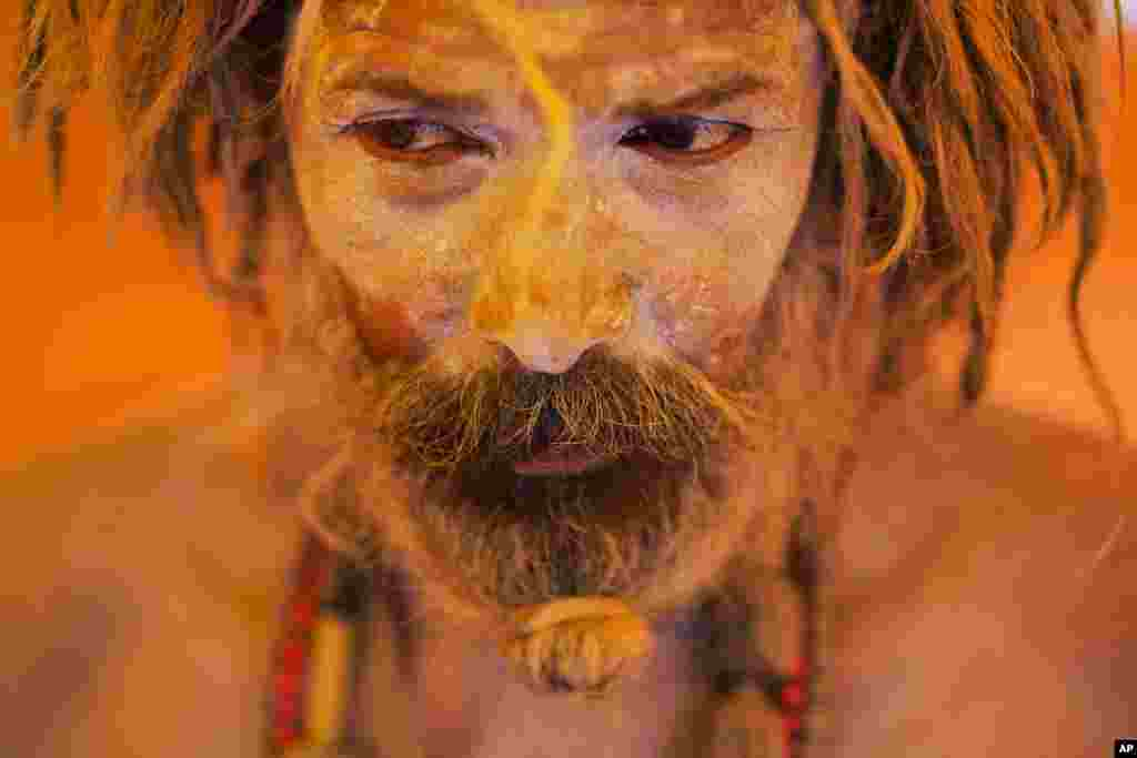 A Naga sadhu, or naked Hindu holy man, pauses inside a tent during Kumbh Mela, or Pitcher festival, at Trimbakeshwar, India.