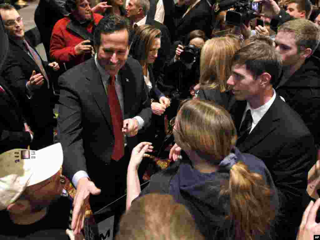 Republican presidential candidate Rick Santorum greets supporters after speaking at a primary night party February 7, 2012, in St. Charles, Missouri. (AP)