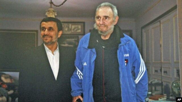 Iran's President Mahmoud Ahmadinejad (L) stands with former Cuban leader Fidel Castro, in Cuba, January 12, 2012.
