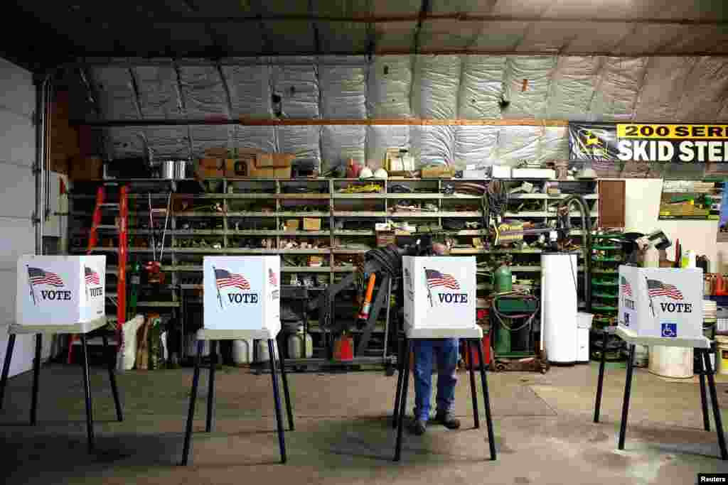 Voters cast their ballots at a polling station set up in a garage near Fernald, Iowa.