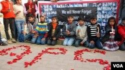 Children holding vigil for army public school peshawar, in Islamabad Pakistan-15 Dec 2015