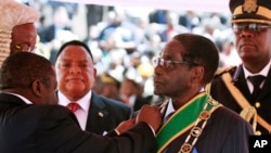 Zimbabwean President Robert Mugabe, 89, is sworn in for his seventh term, in Harare, Aug. 22, 2013.