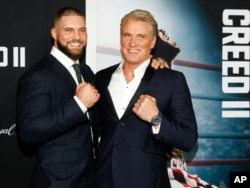 """Florian Munteanu, left, and Dolph Lundgren, right, attend the world premiere of """"Creed II"""" at the AMC Loews Lincoln Square in New York, Nov. 14, 2018."""